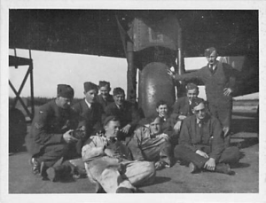 Ground crew. Edward McHugh, wearing overalls, is in the front.